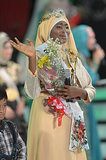 The newly crowned winner of the Muslimah World competition, Obabiyi Aishah Ajibola, waved her hand to the audience in Jakarta.
