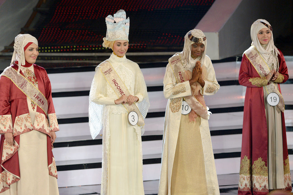 The contestants stood on stage during the competition.