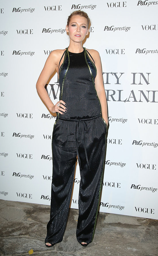 Blake Lively rocked a black jumpsuit from Gucci's Spring 2014 collection for the Beauty in Wonderland event during Milan Fashion Week.