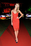 As if she's not bombshell enough, Rosie Huntington-Whiteley went ahead and showed us just how sultry she can be in a red lace tank slip dress at the Martini 150th Anniversary gala in Lake Como, Italy.
