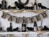 Make your mantel haunted hanging this banner ($15), and use all black accents.