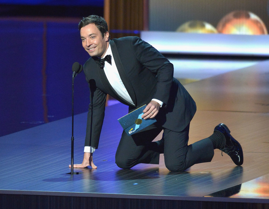 Jimmy Fallon couldn't help laughing when the microphone kept going up and down at the Emmys.
