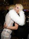 Miley Cyrus hugged Britney Spears.