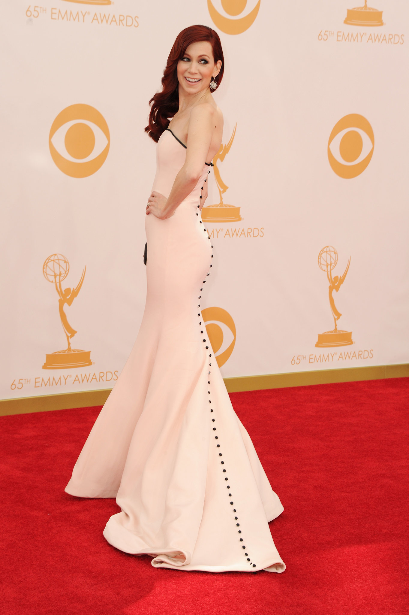 It was all about the rear view for Carrie Preston's Romona Caveza dress. The pale pink color and train were accented by a long row of buttons.