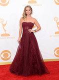 Big Bang Theory actress Kaley Cuoco dazzled in strapless, burgundy red Vera Wang on the Emmys red carpet.
