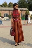 Miroslava Duma topped her leather skirt with a little buttoned-up plaid.