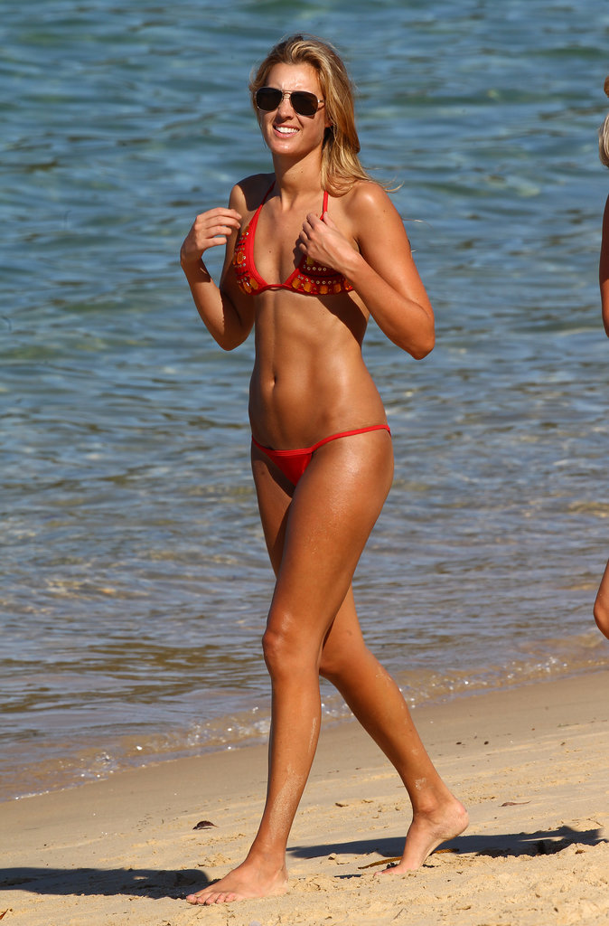Laura Dundovic wore a red bikini on a Sydney beach in September 2013.