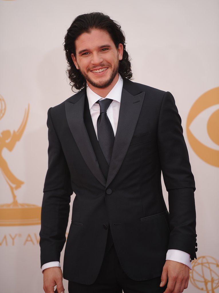 Game of Thrones stud Kit Harington grinned on the Emmys red carpet.