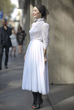 Ulyana Sergeenko captivated the crowd in femme white full skirt, then edgy black boots.