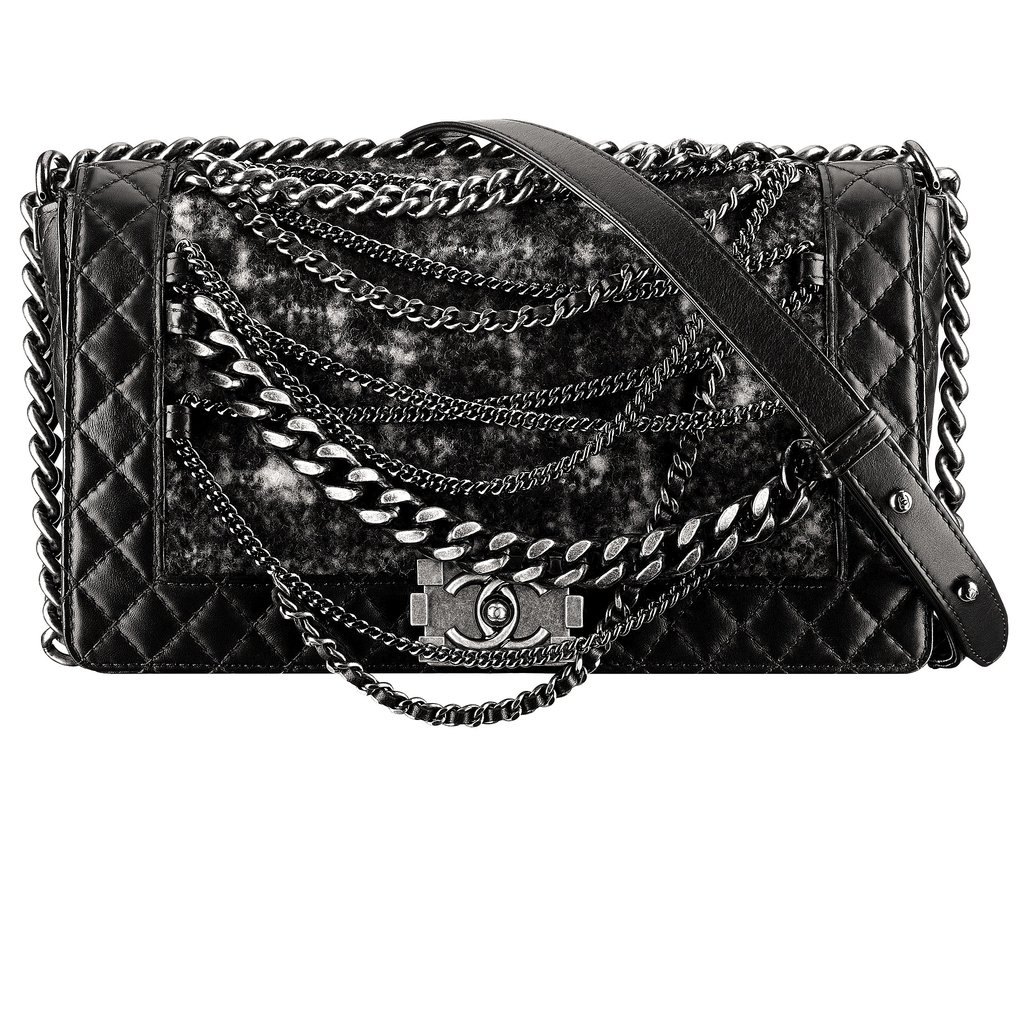 Chanel Black Quilted Leather and Tweed Boy Chanel Bag With Chains Photo courtesy of Chanel