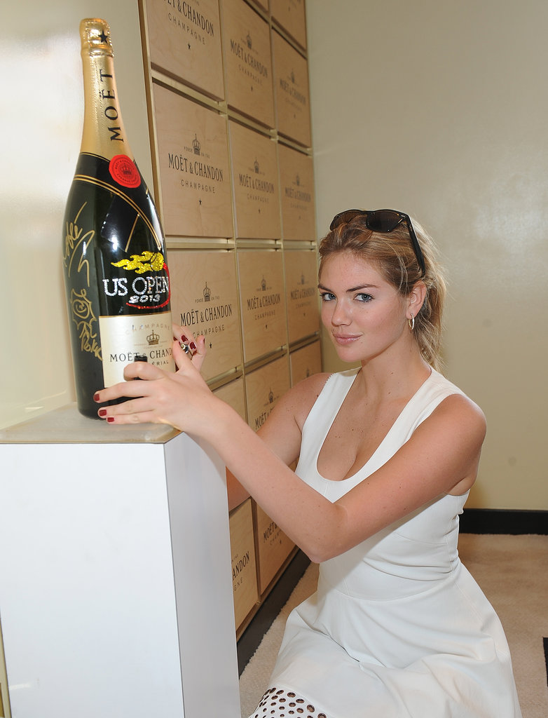 Kate Upon showed off her casual side at the Moet and Chandon Suite at the 2013 US Open. A casual updo and bright red nails made for a gorgeously breezy look.