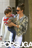 Miranda Kerr carried her son, Flynn Bloom.