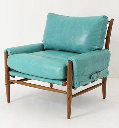 The plump leather cushions in this Rhys Chair ($2,498) come in a bevy of playful colors. We can't help but gush over the belted details on the side!