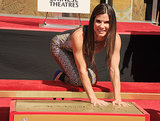 Sandra Bullock celebrated the release of Gravity with a hand- and footprint ceremony at the TCL Chinese Theatre on Wednesday.