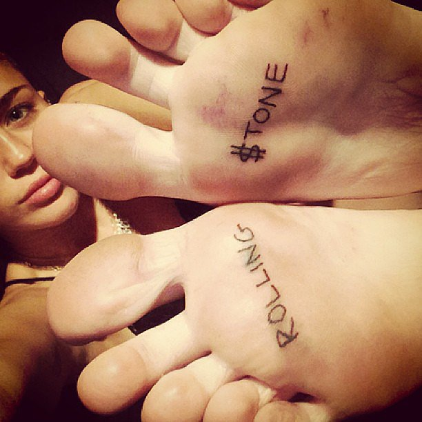 """Miley Cyrus showed off her new """"Rolling $tone"""" foot tattoos. Source: Instagram user mileycyrus"""