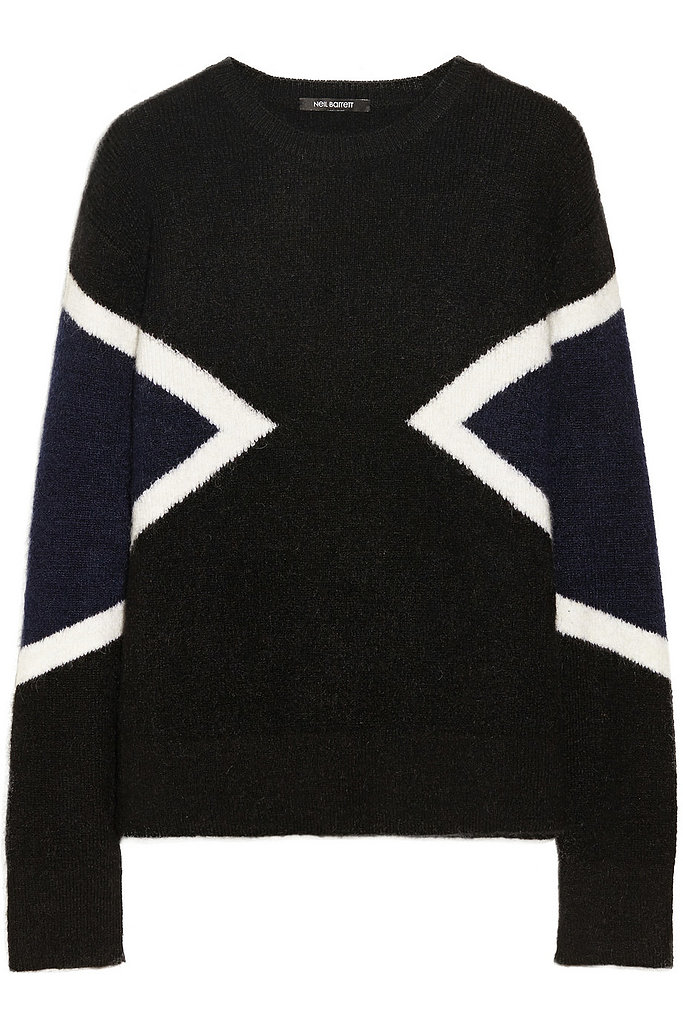 When October hits, I know it's finally time to pull out all of my sweaters, and this Fall, I'm looking forward to beating the cold in something that's high contrast and graphic. This Colorblock Knitted Sweater from Neil Barrett ($580) hits the mark perfectly. — JF