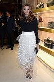 Olivia Palermo tucked a black sweater into a sheer white tulle maxi skirt then amped things up with a pair of printed pumps at the Chloé Attitudes book launch in Paris.