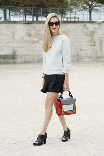 Joanna Hillman added a color punch to her look with a bright bag.