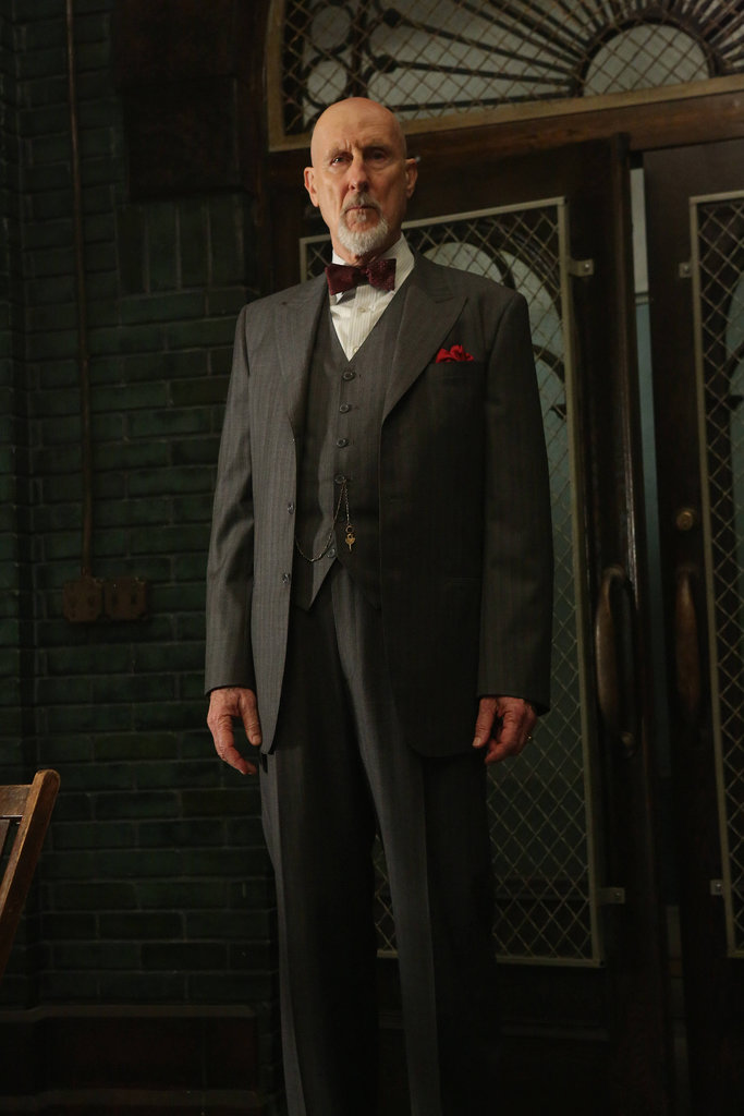 Dr. Arthur Arden  What to wear: A gray, three-piece suit with a white shirt, a red bow tie, and a matching pocket square. Grow a goatee, and paint it white (unless it's already white). How to act: Carry around a bucket of meat scraps and some electric shock pads.