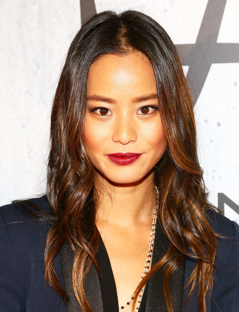 Sticking with a more polished version of beach waves, Jamie Chung accented her look with a wine lipstick hue that's fitting for Fall.