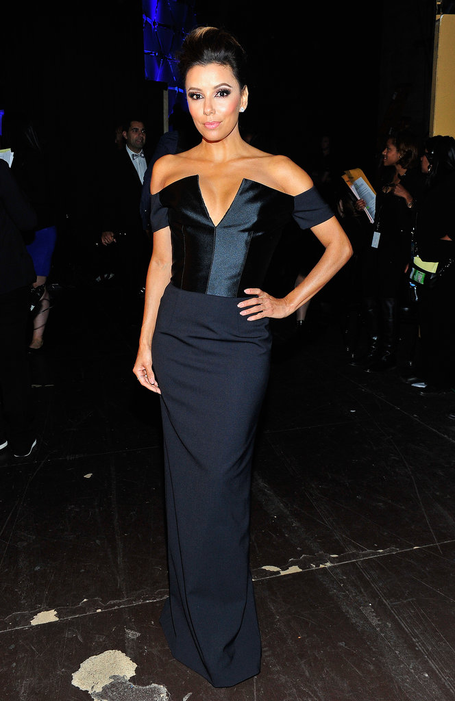 Backstage at the 2013 Alma Awards, Eva Longoria put her décolletage on display in a navy off-the-shoulder Etro gown. We love the mix of varying fabrics and that dramatic v-neck.