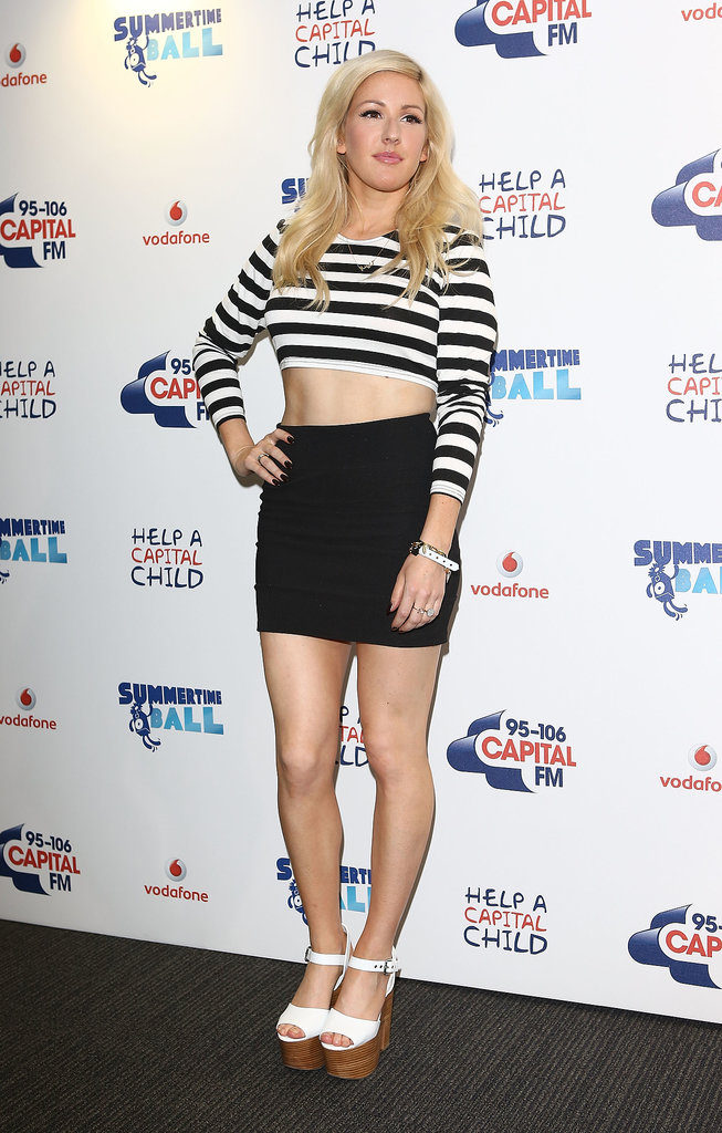 Ellie Goulding paired a striped crop top with a black miniskirt, then finished with white platform sandals by Topshop at the Capital Summertime Ball in London.
