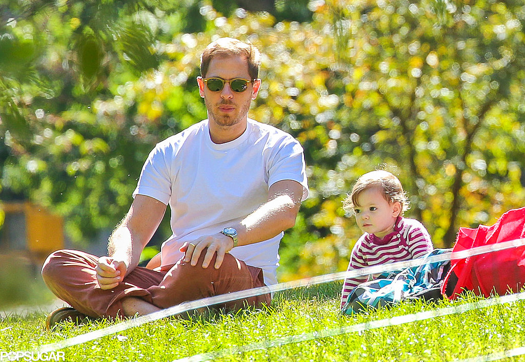 Will and Olive Kopelman sat in the grass at Central Park.