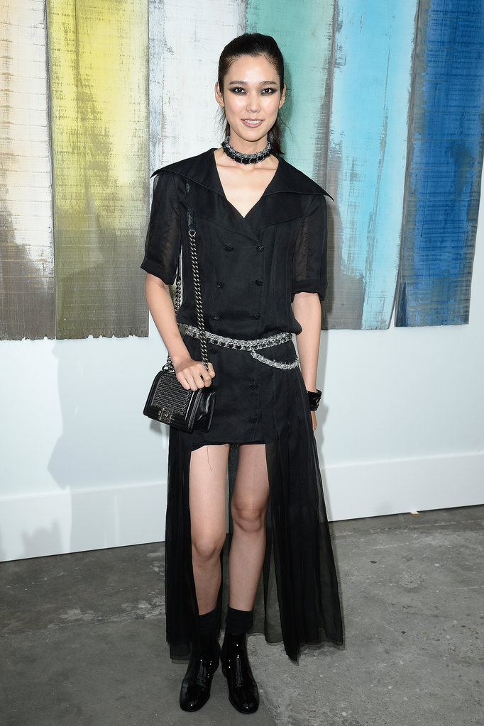 Tao Okamoto bared her gams in an asymmetric black design at Chanel.