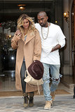 The couple walked hand in hand in Paris the day they arrived, with Kim sporting a tan overcoat with gray leggings.