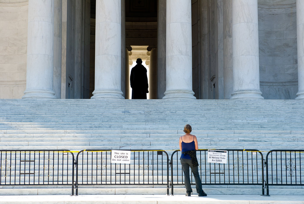 A woman stood behind barriers while visiting the Jefferson Memorial in Washington DC.