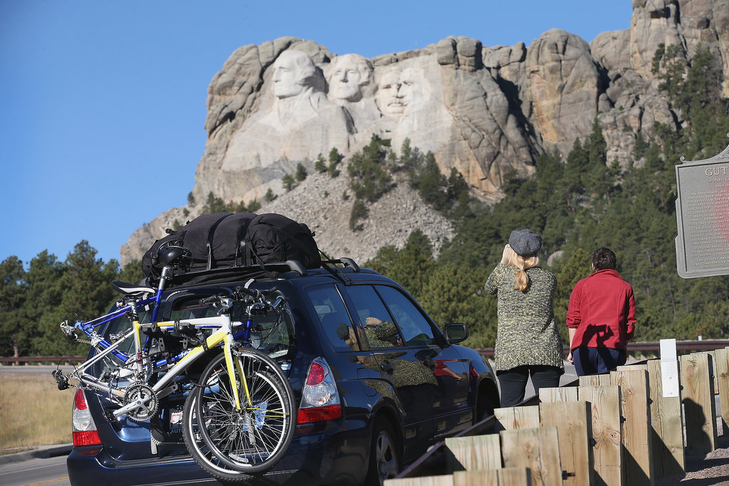 Since the national parks were closed, tourists stopped on the highway to snap pictures of Mount Rushmore in Keystone, SD.
