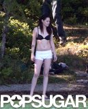 Kristen Stewart stood on the bank as she prepped to splash into the water.
