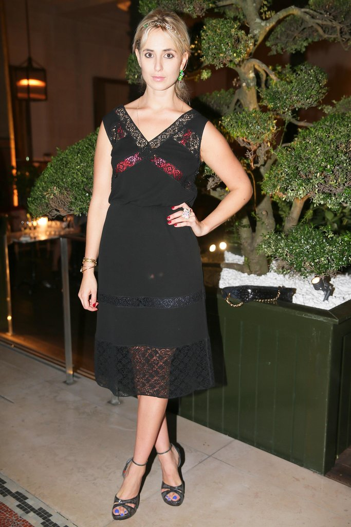 Elisabeth von Thurn und Taxis hosted a Parisian dinner in a vampy peekaboo LBD.