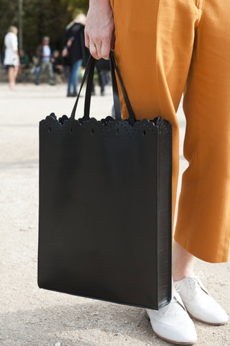 A little laser-cut leather gives a basic tote a unique upgrade.
