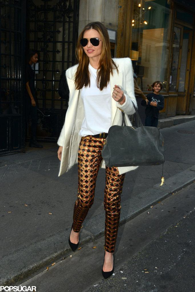 Miranda Kerr put her most fashionable foot forward in the City of Light as she showed off a Balmain ensemble, including flashy metallic-print pants.