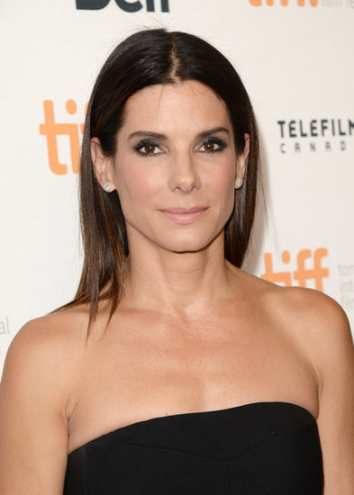 For the Gravity premiere at the Toronto International Film Festival, Sandra went for a sleek look, from the strapless dress to her straightened locks. She tucked her hair behind her ears and kept the focus on her eyes with a gray smoky look.