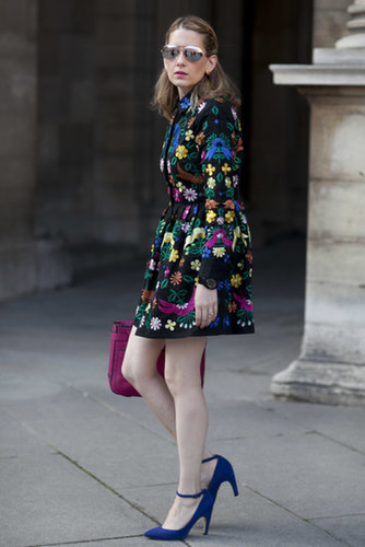 This showgoer opted for a bold ASOS dress accented with colorful extras and mirrored Cynthia Rowley shades.