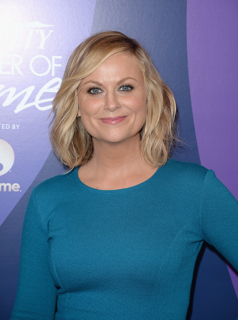 Amy Poehler paired a curly lob with loads of black eyeliner.
