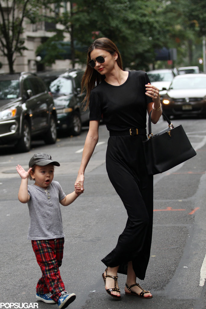 Miranda Kerr held Flynn Bloom's hand on Sunday during an NYC stroll.