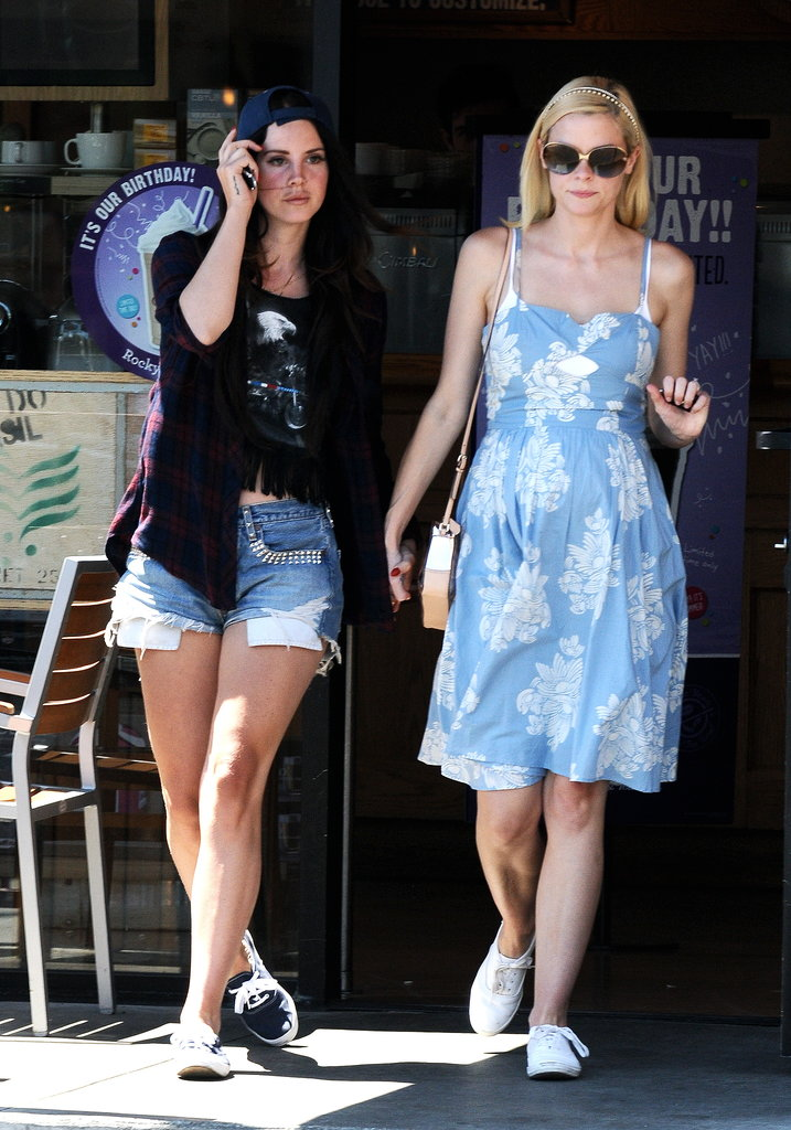 Jaime King was wonderfully feminine in a blue floral dress while hanging out with Lana Del Rey in LA. We love that instead of obvious sandals, she finished with sporty white sneakers.