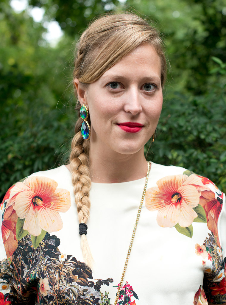 A braid, sideswept bangs, and red lipstick make up this easy-to-re-create look.