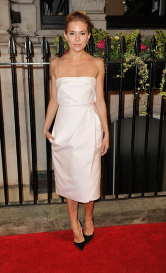 Sienna Miller made the perfect style pairing when she wore classic black pumps with a chic white dress and De Beers diamonds at the BFI gala dinner in London.