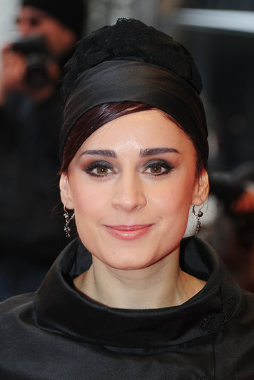 An updo can be elevated by a thick headband, too. Maryam Moghadam wore a black silk-and-lace combination over her red carpet style.