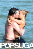 Sam Worthington and Lara Bingle showed PDA on the beach in Sydney, Australia.