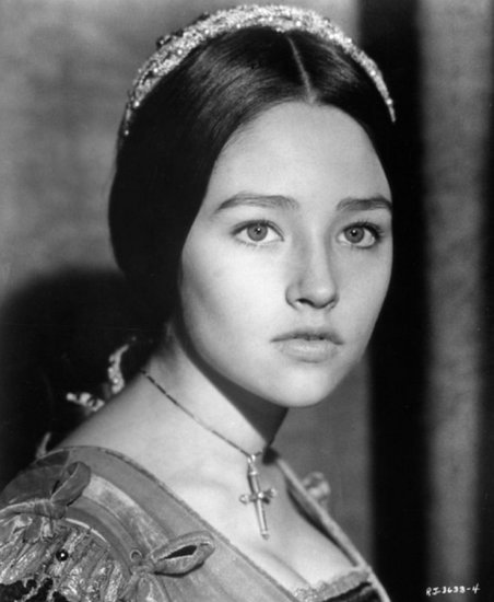 Olivia Hussey, decked out in gilded headwear, a middle part, and a decorated ponytail, glamorously portrayed Juliet in 1968.  Source: Paramount Pictures