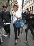 Kate Upton popped up in Paris playing the part of chic star in a white blouse, black skinny jeans, classic pumps, and a Céline luggage tote.