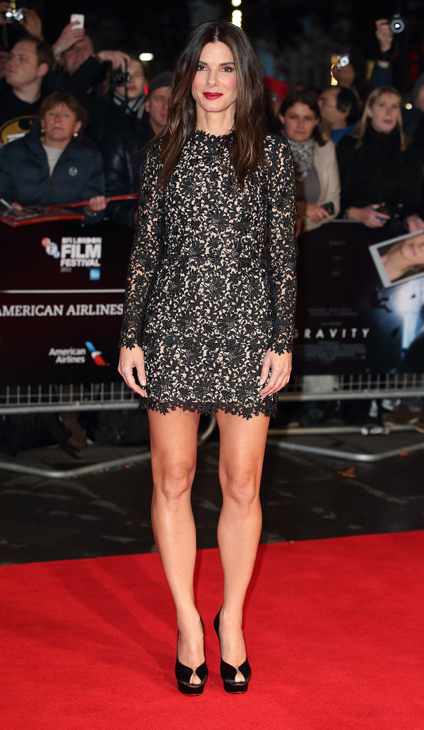 Sandra Bullock wore a short lace Stella McCartney dress.