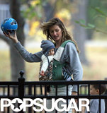 Gisele Bündchen played with a ball at the park.