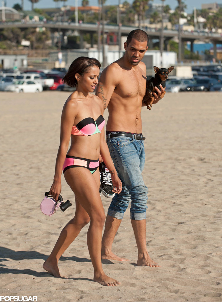 Kat Graham and Cottrell Guidry walked on the beach.