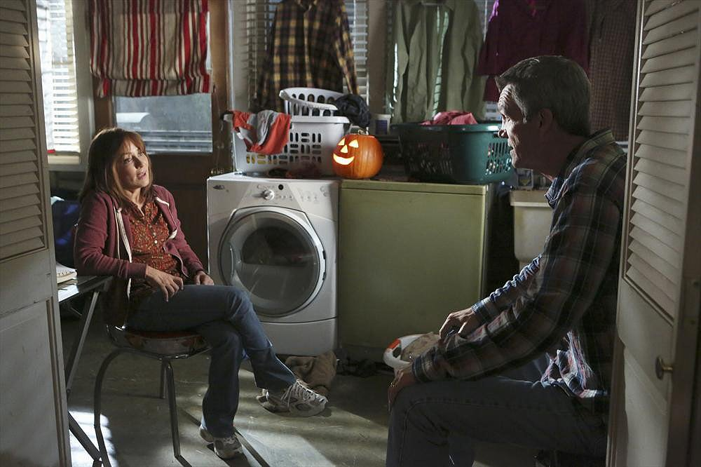 "The Middle Frankie (Patricia Heaton) and Mike (Neil Flynn) on The Middle's Halloween episode, ""Halloween IV: The Ghost Story,"" airing Oct. 30."